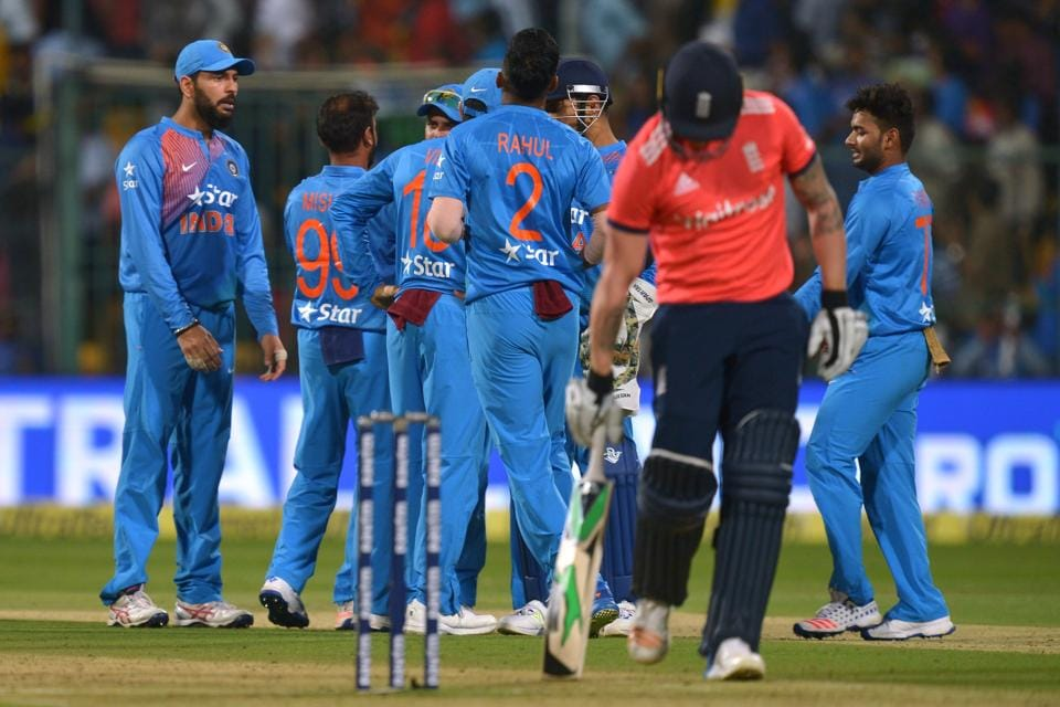 Indian players celebrate the dismissal of England batsman Jason Roy during the third T20 match at the Chinnaswamy Stadium in Bangalore on Wednesday. England lost by 75 runs to lose the three-match series 2-1.