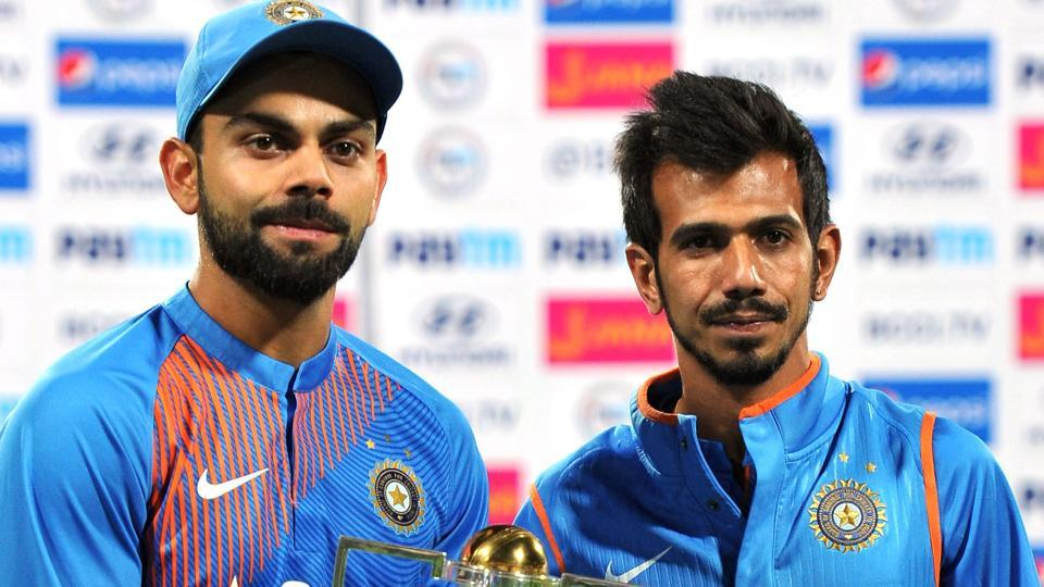 Virat Kohli (L) and Yuzvendra Chahal pose after India cricket team's T20 series win over England.