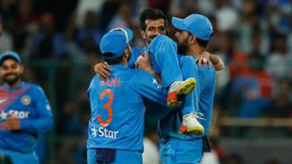 Yuzvendra Chaha gets picked up by Yuvraj Singh as the legspinner picked up a record haul of 6/25 in the third T20I versus England at the Chinnaswamy stadium.