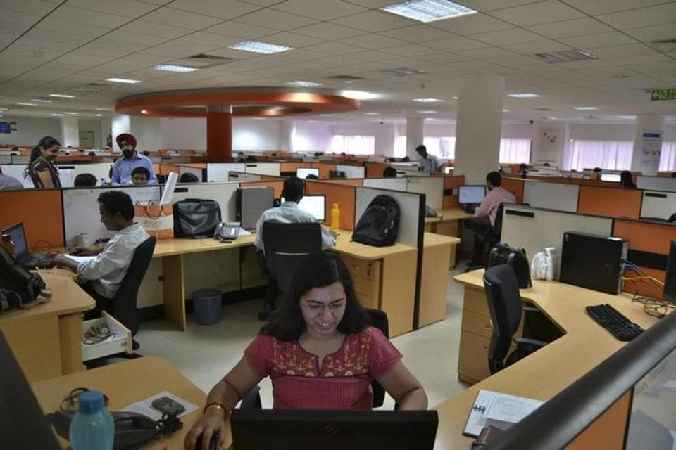 Employees work at the Indian headquarters of iGate in the southern Indian city of Bangalore.