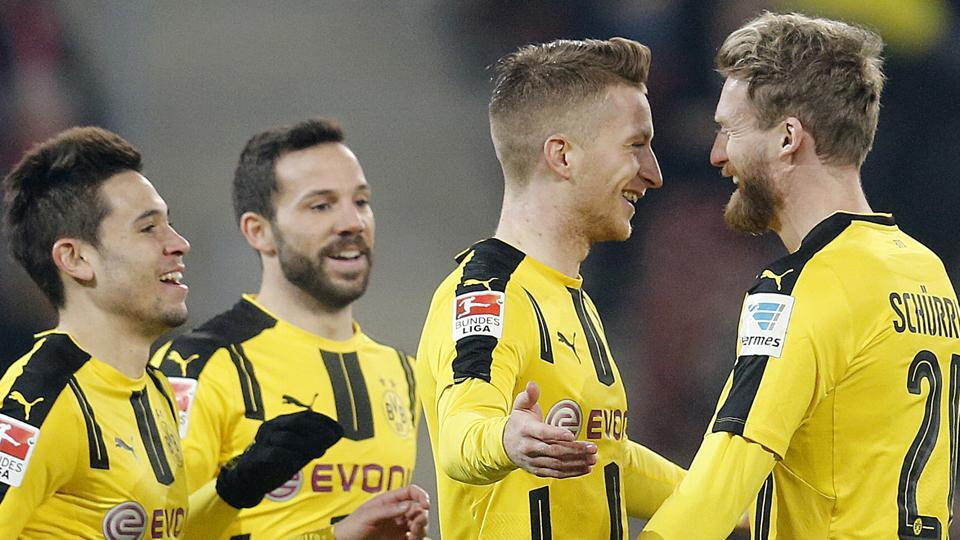 Dortmund's Marco Reus, 2nd right, celebrates his side's opening goal during a Bundesliga match against FSV Mainz 05.