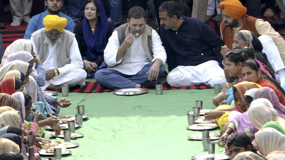 Congress vice-president Rahul Gandhi eats lunch with villagers at Ballian village in Sangrur on Thursday.