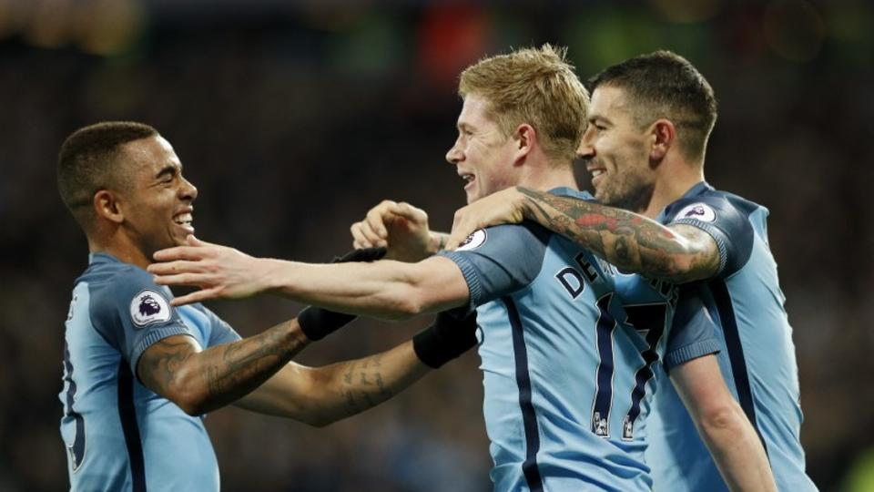 Manchester City's Kevin de Bruyne celebrates with teammates after scoring their first goal against West Ham United in the Premier League on Wednesday. Gabriel Jesus scored his first goal for City in the match.