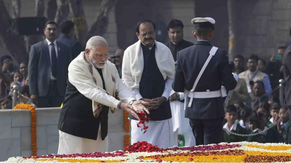 """Prime Minister Narendra Modi, pays tributes at Rajghat, a memorial to Mahatma Gandhi, on his death anniversary in New Delhi.  There's nothing dilettante-ish about the government's celebrations of these anniversaries, especially those around Mohandas Karamchand Gandhi. None other than Prime Minister Narendra Modi has decided he will head the high-level committee that will soon be set up to celebrate these historical dates in a """"befitting"""" manner"""