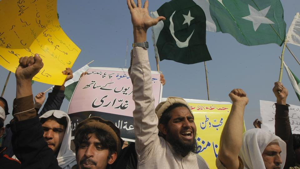 Supporters of Hafiz Saeed shout slogans to condemn his arrest, during a rally in Peshawar, Pakistan.
