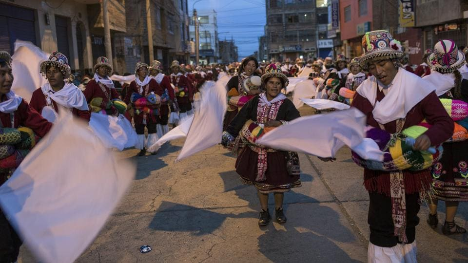 Dancers perform during Virgin of Candelaria celebrations in downtown Puno, Peru.
