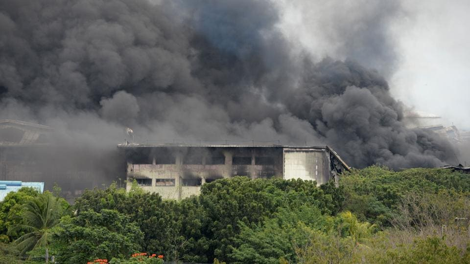 Black smoke billows from a burning factory building belonging to House Technologies Industries, a Japanese-owned company, at the Export processing Zone (EPZA) in General Trias town, Cavite province, southwest of Manila on February 2.
