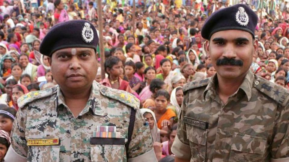 Senior Chhattisgarh police officer SRP Kalluri (left) stands with his colleague RN Dash in this photo. Kalluri is accused of using illegal tactics in his crackdown on Maoist rebels.