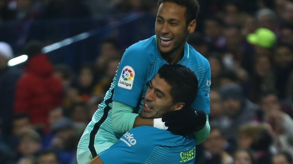 FC Barcelona's Luis Suarez celebrates with Neymar (top) after scoring the opening goal against Atletico Madrid in their Spanish Copa del Rey (King's Cup)semifinal first leg match at the Vicente Calderon stadium in Madrid.