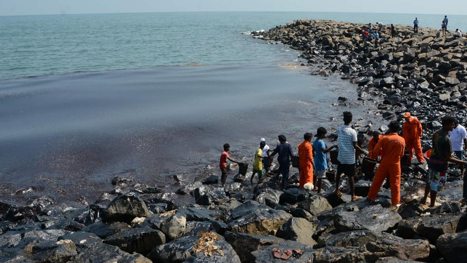 Coast Guard pollution response team tackles the oil spill in the sea at Ernavoor, north Chennai.