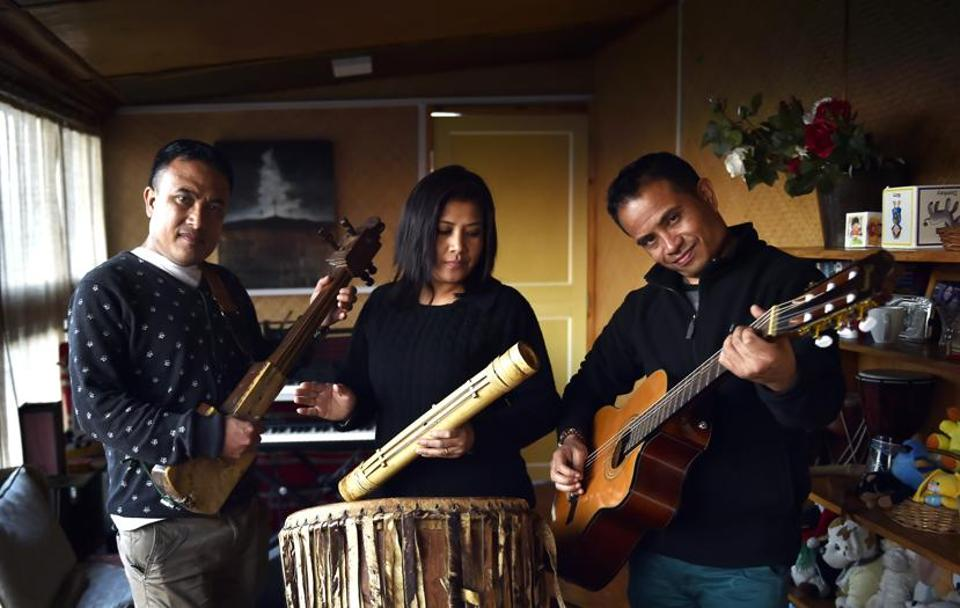 Brothers Kit (above right) and Ador Shangpliang (who plays the traditional duitara) of the prominent Shillong-based band Summersalt. Kit's wife Pysnsuklin is the band's vocalist. Summersalt has played for the Bollywood film Rock On 2.