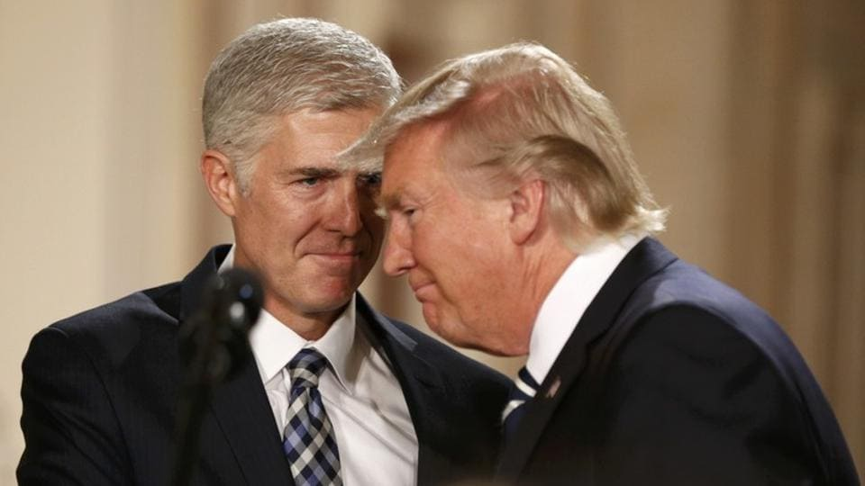 U.S. President Donald Trump and Neil Gorsuch (L) smile as Trump nominated Gorsuch to be an associate justice of the U.S. Supreme Court at the White House in Washington, D.C..