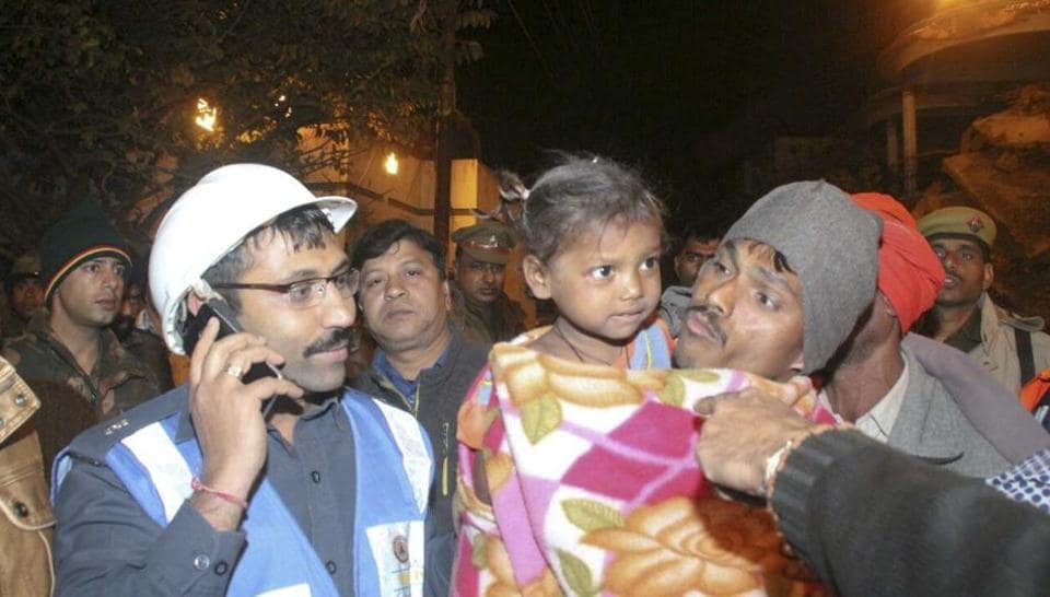 Swati reunites with her father after being rescued, in Kanpur.