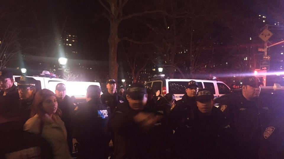 Police at NYU campus after fights broke out at a protest against an appearance by Gavin McInnes.