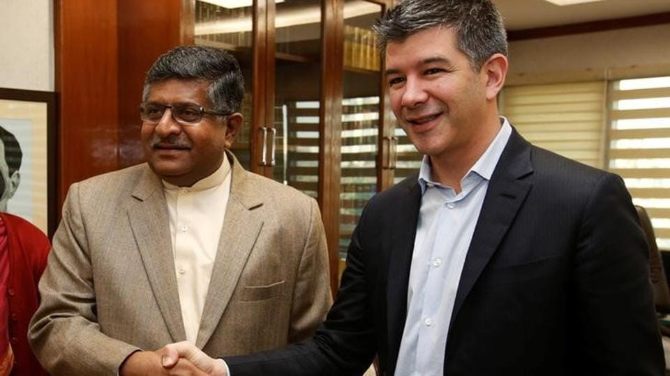 A file photo shows minister of law and information and technology Ravi Shankar Prasad (L) shaking hands with Uber CEO Travis Kalanick before the start of their meeting in New Delhi, India.