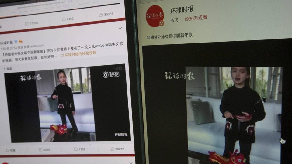 Computer screens display a video clip showing U.S. President Donald Trump's granddaughter Arabella Kushner singing a Chinese New Year greeting song that garnered almost 20 million views in Beijing.