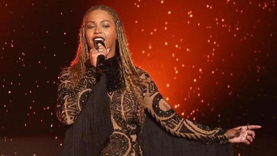Beyonce announced her pregnancy by posting pictures of her baby bump on her website Beyonce.com on Thursday.
