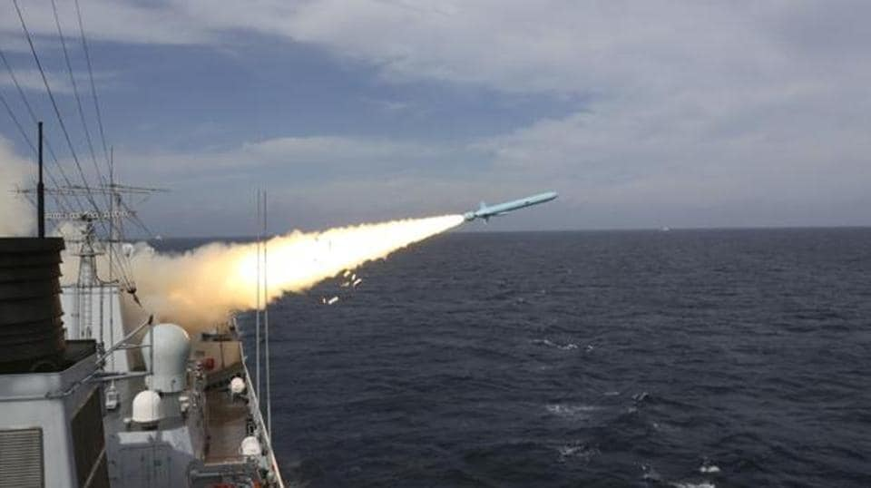 In this Monday, Aug. 1, 2016 photo released by Xinhua News Agency, a missile is launched from a guided-missile destroyer during a live ammunition drill in the East China Sea.