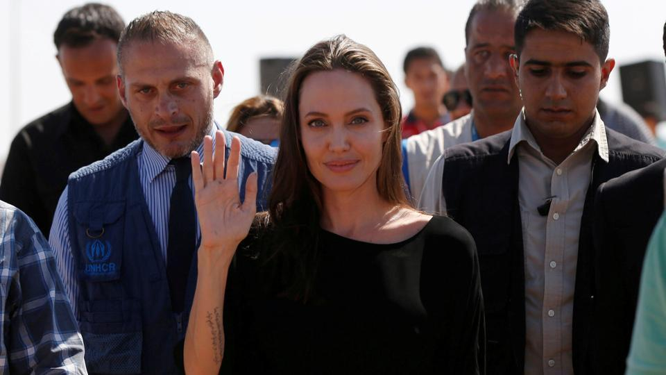 FILE PHOTO - Actress Angelina Jolie leaves after a news conference at Azraq refugee camp for Syrians displaced by conflict, near Al Azraq city, Jordan.