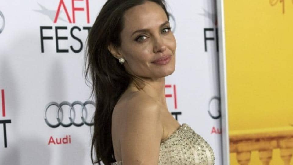 Director and cast member Angelina Jolie poses at the premiere of By the Sea.