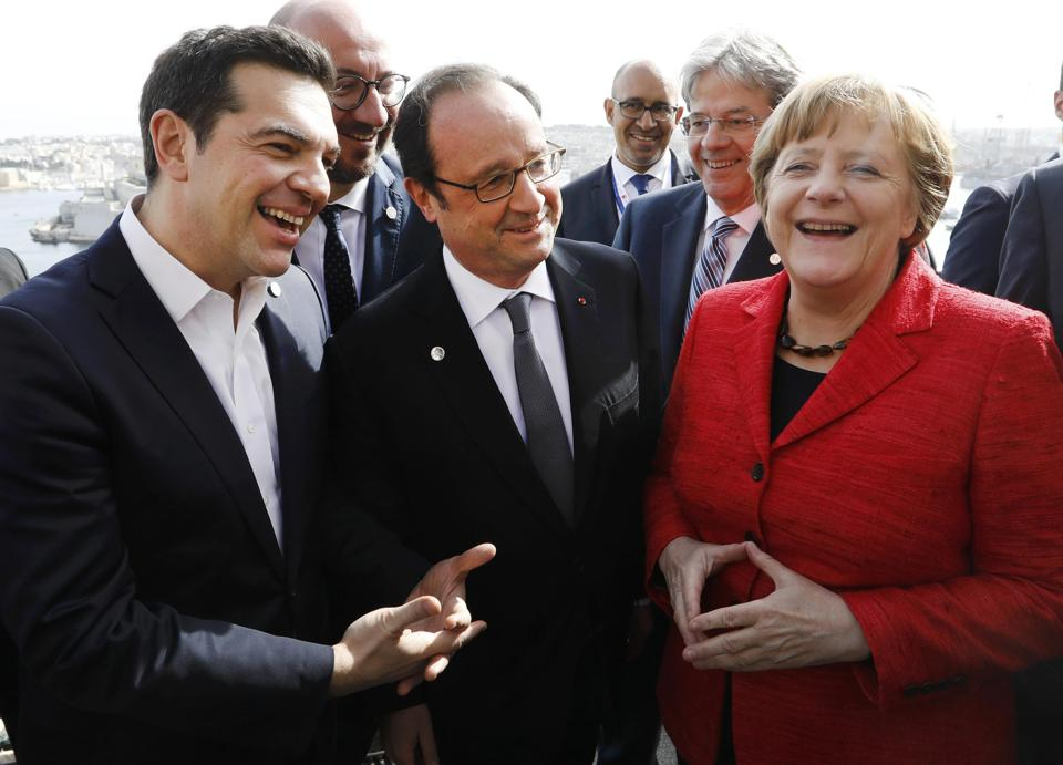 Greek Prime Minister Alexis Tsipras, French President Francois Hollande and German Chancellor Angela Merkel during a break in the European Union leaders summit in Valletta in Malta.