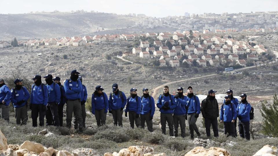 File photo from February 1, 2017 shows Israeli security forces gather at Amona outpost, northeast of Ramallah, as they prepare to evict hardline Jewish occupants of the wildcat settlement outpost in line with a high court ruling that determined the homes were built on private Palestinian land.