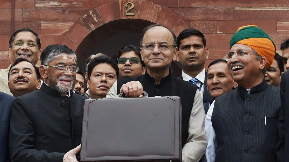 Finance minister Arun Jaitley (C) stands outside his office at North Block holding the briefcase containing the Union budget for 2017 and is flanked by MoS Arjun Meghwal (R) and Santosh Gangwar (L), on Wednesday.
