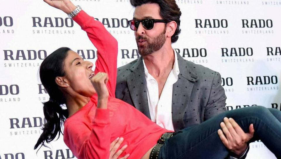 Hrithik Roshan with a fan during an event to promote Kaabil in Kochi. (PTI)