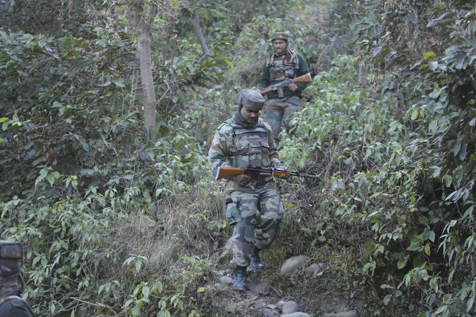 Soldiers patrol during a search operation in the frontier Battal area, about 90 km from Jammu.