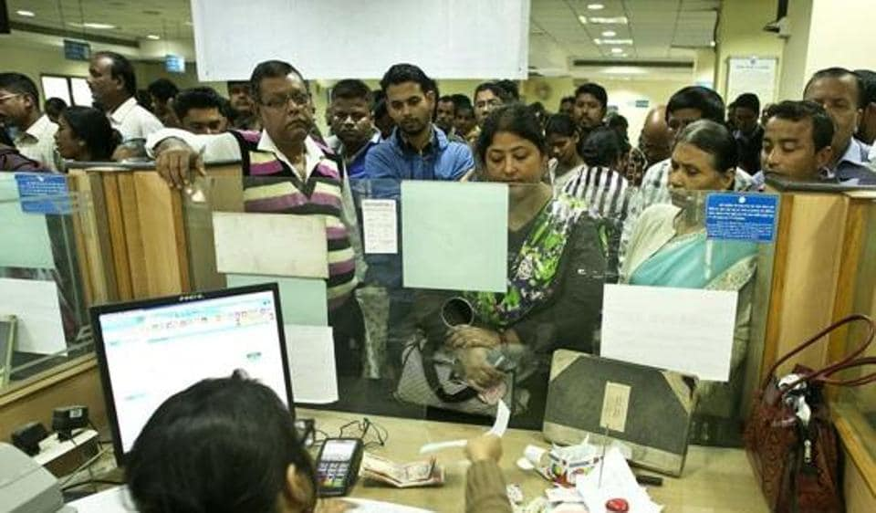 Indians deposit discontinued notes in a bank in Guwahati, after the government in a surprise move demonetised Rs 500 and Rs 1000 notes on November 8.