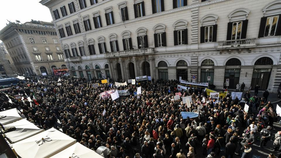 People demonstrate against the slow bureaucracy of the government in sending economic help to the earthquake-ravaged zones of central Italy during a protest in Rome on January 25, 2017.