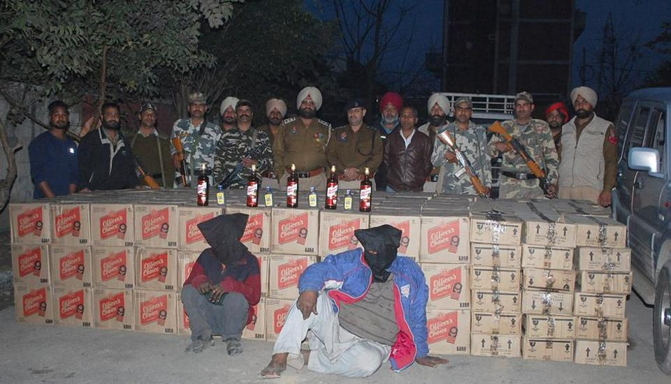 A police team displaying the seized liquor cases in Phagwara on Thursday.