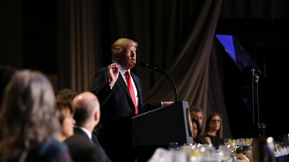 US President Donald Trump delivers remarks at the National Prayer Breakfast in Washington.
