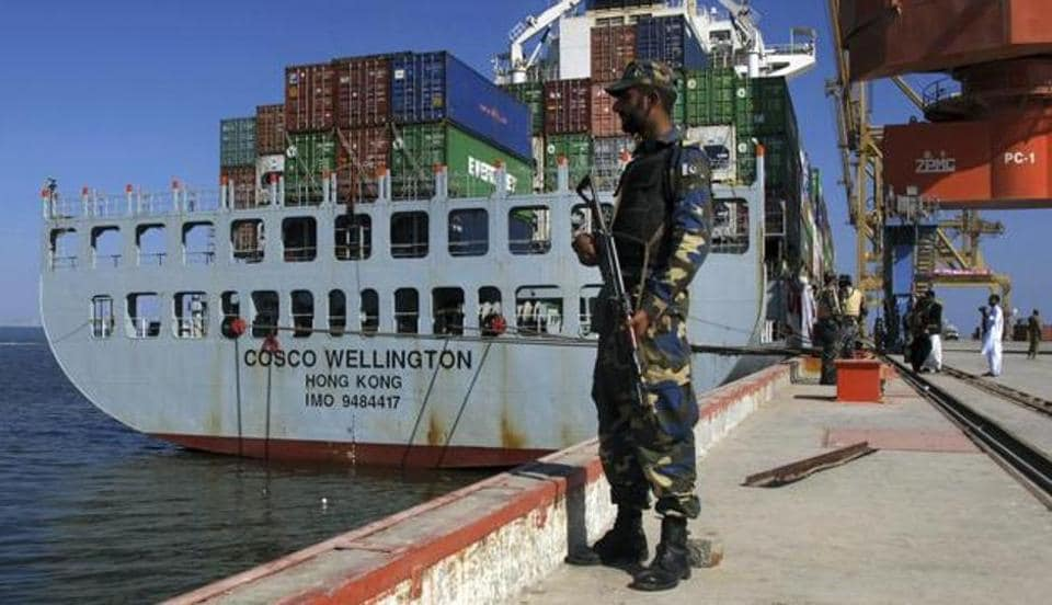 A Pakistan Navy soldier stands guard while a loaded Chinese ship is readied for departure prior to a ceremony at Gwadar port, about 435 miles, 700 km, west of Karachi.