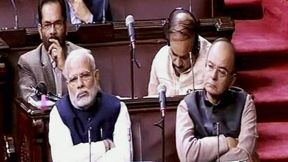 Prime Minister Narendra Modi (L) and finance minister Arun Jaitley in Rajya Sabha, New Delhi.