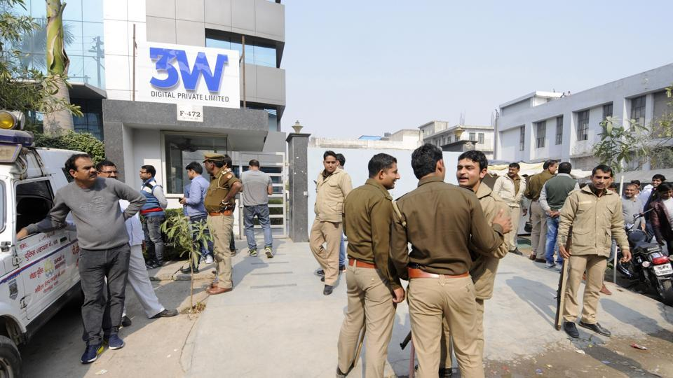 Noida: Police outside the office of Ablaze Info Solutions Limited in Noida Sector 63 on Friday. Investors in the firm had gathered outside the company to both protest and support it.