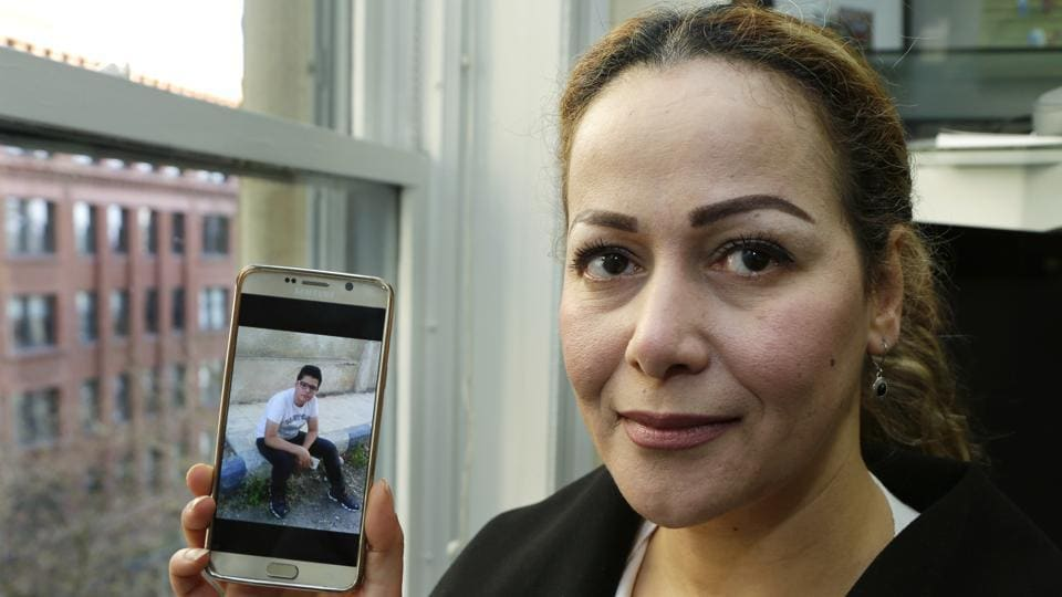 Reema Duhman in Seattle shows a photo of her son stuck in Syria.