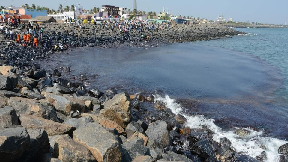 Coast Guard Pollution Response Team tackles the oil spill in the sea at Ernavoor. A report by Indian National Centre for Ocean Information Services says that the spillage has polluted 24.06 km of the Chennai's coastline.
