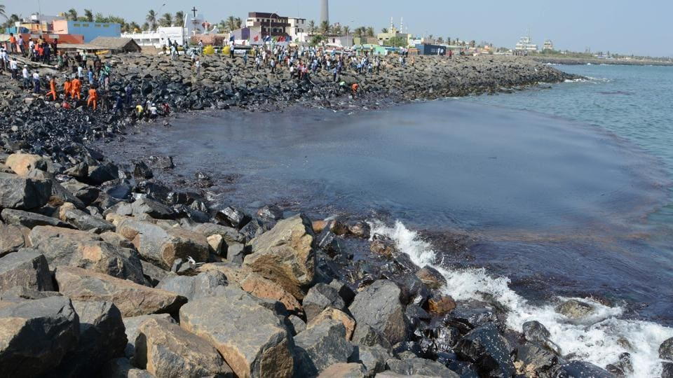 The Coast Guard Pollution Response Team tackling the oil spill in the sea at Ernavoor, north Chennai.