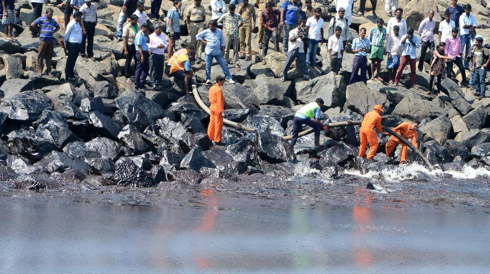 The Coast Guard Pollution Response Team tackles the oil spill in the sea at Ernavoor. Over 1,000 personnel from various government departments were involved in the clean-up of the shoreline.