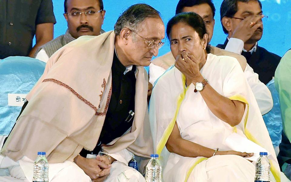 West Bengal CM Mamata Banerjee with state finance minister Amit Mitra at the State Panchayat Sammelan in Kolkata on Friday.
