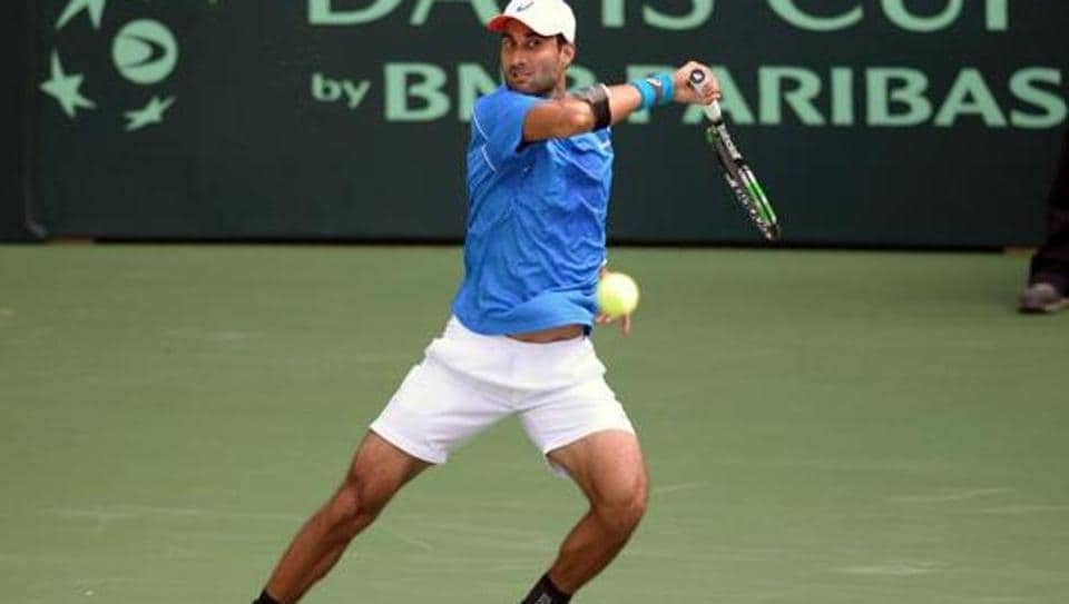 India's Yuki Bhambri returns a shot during his Davis Cup singles match against New Zealand's Finn Tearney at the Balewadi Sports Complex in Pune.
