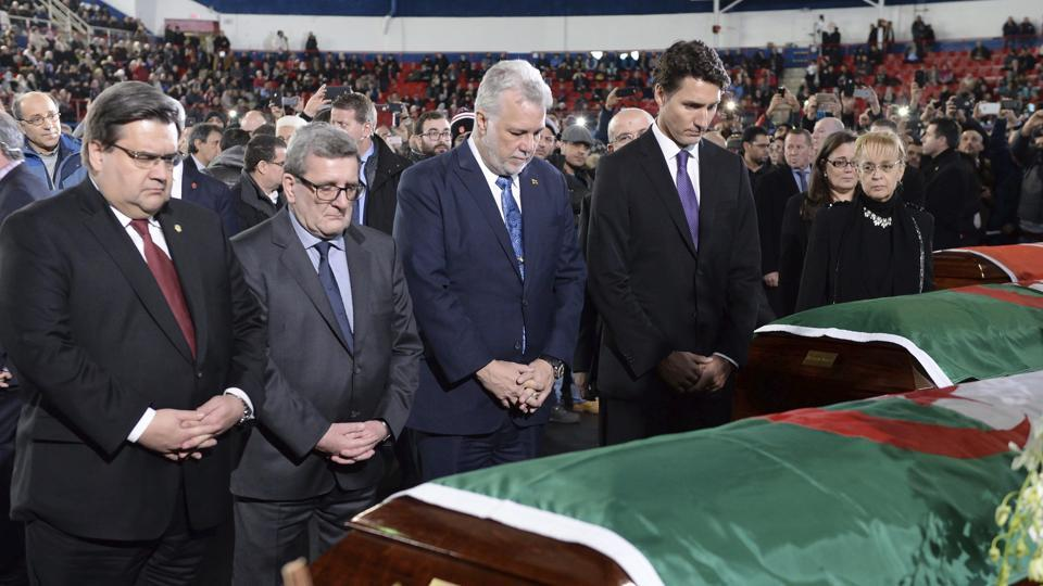 (From right) Canada Prime Minister Justin Trudeau, Quebec premier Philippe Couillard, Quebec city mayor Regis Labeaume and Montreal mayor Denis Coderre pay their respects to three victims of the mosque shooting during their funeral in Montreal.