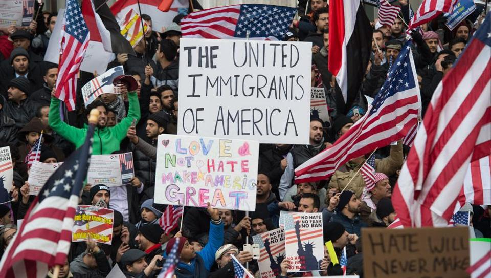 People rally with flags at Brooklyn Borough Hall as Yemeni bodega and grocery-stores shut down to protest US President Donald Trump's Executive Order banning immigrants and refugees from seven Muslim-majority countries, including Yemen, on February 2, 2017 in New York.