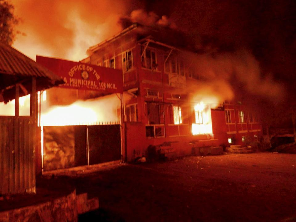 Naga tribals set ablaze the Kohima Municipal Council office and the office of the district collector to protest against chief minister TR Zeliang's refusal to meet their ultimatum, in Kohima, February 2