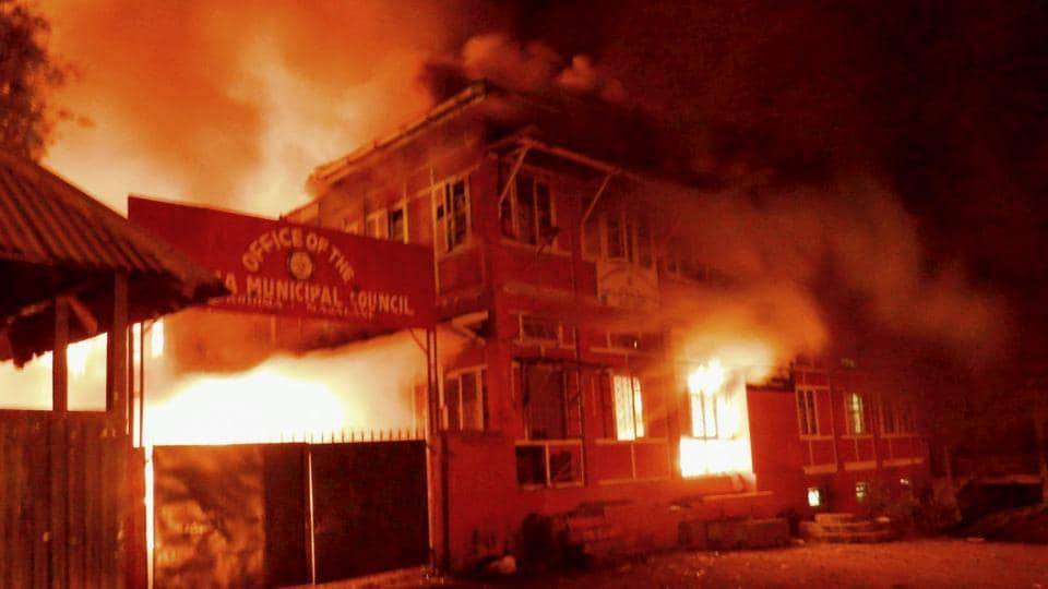 Naga tribals set ablaze the Kohima Municipal Council office and the office of the district collector to protest against chief minister TR Zeliang's refusal to meet their ultimatum, in Kohima.