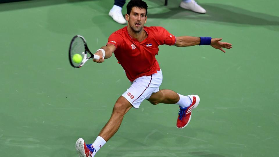 Novak Djokovic lost the first set and needed treatment on his shoulder but overcame the odds to defeat Daniil Medvedev and help Serbia take a 2-0 lead over Russia in the Davis Cup World Group encounter.