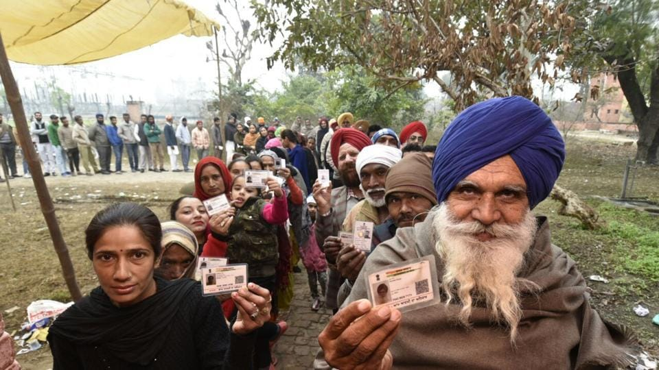 Villagers show their voter identity cards before voting at Majitha constituency polling station Amritsar, Punjab. (Gurpreet Singh/HT Photo)