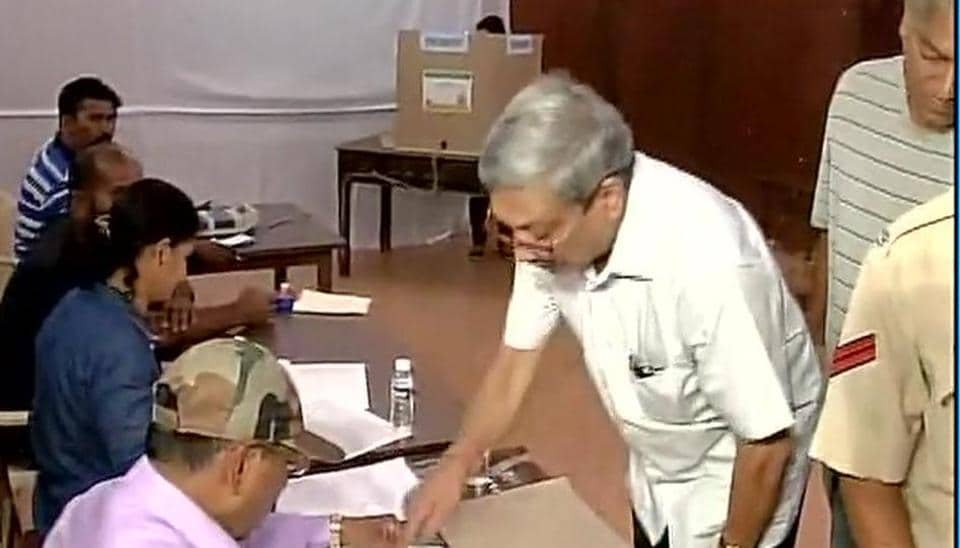 Defence minister Manohar Parrikar casts his vote at a polling station in Goa's Panaji.