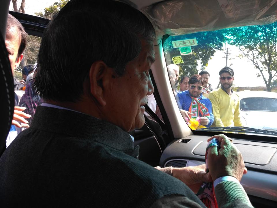 Chief minister Harish Rawat during a roadshow in Jaspur constituency.